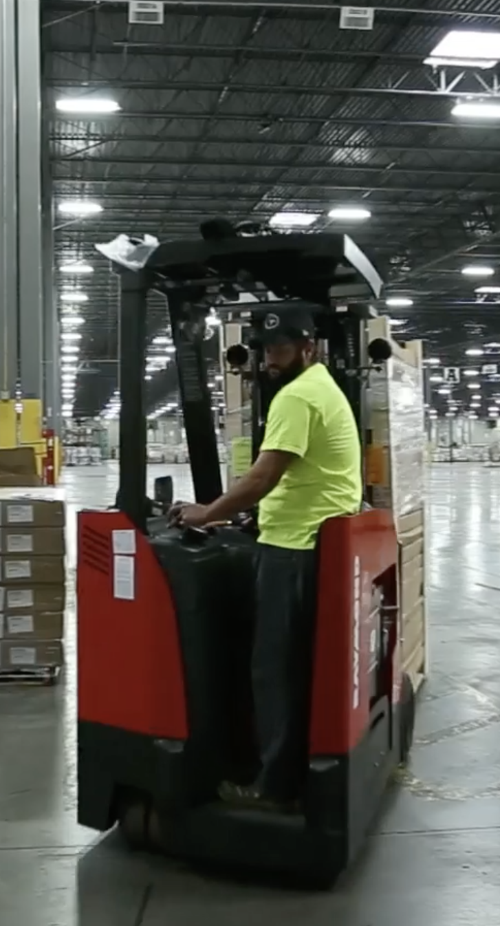 Retail Warehouse worker using fork lift